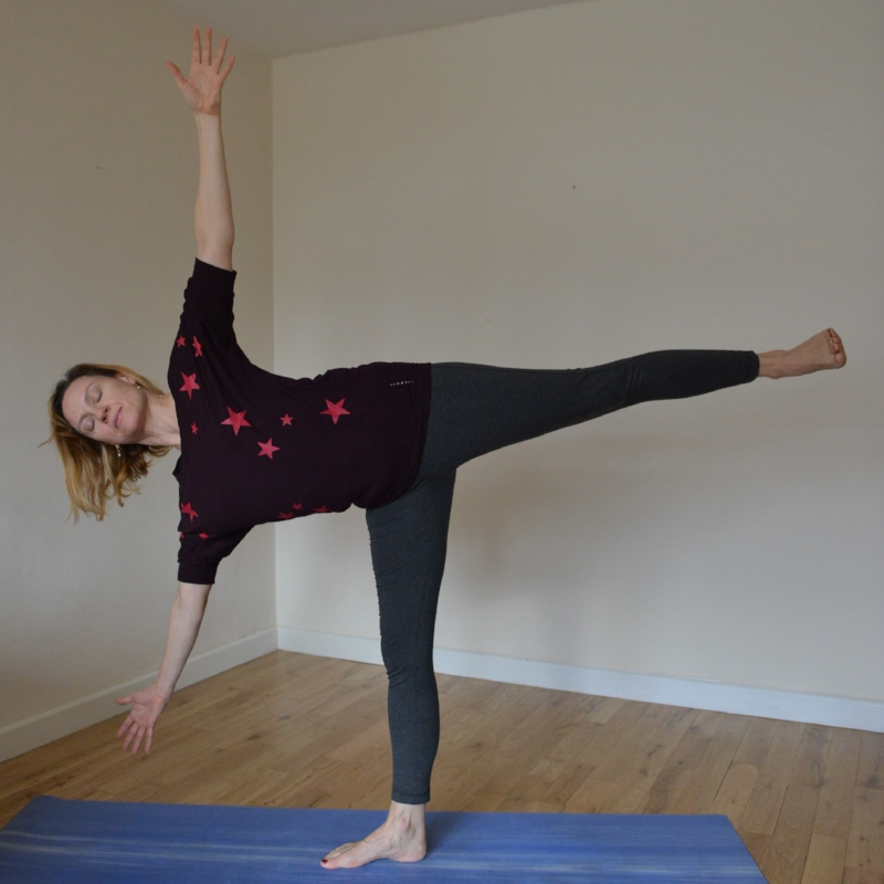 Ardha Chandrasana - This challenging balance is the perfect expression of sthira and sukha, giving you the opportunity to slowly expand from the earth into perfect balance.From Tadasana, step forward with one foot, lift up through your arch, lengthen the front of your hips and side body, gradually tilting over with open hips and raising your back leg.Keep your back leg and body in a line and invite your arms to expand from your body. Do not aim at the floor.Having the hand away from the floor makes it equally accessible and challenging to all. If you find balance challenging keep the back leg low and the tilt small to maintain the line from head to toe. If you love a strong balance and your leg comes up parallel to the floor, your hand may well find the floor, resist the urge to rest on it!