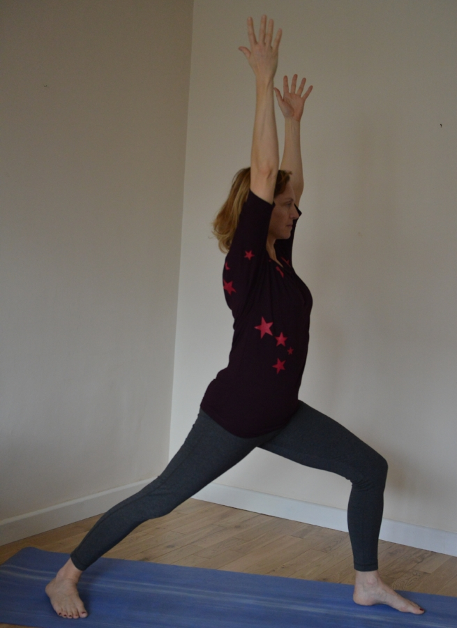 Virabhadrasana / Trikonasana Flow - Hold each pose for at least three rounds of breath, try to re-create the firm base and support in your lower body and lightness in your upper body that you found in Tadasana.Virabhadrasana IStart with a strong warrior base, front knee tracking in-line with your front toes and back foot at a diagonal angle away from your front foot. Arms up, steady gaze forward.