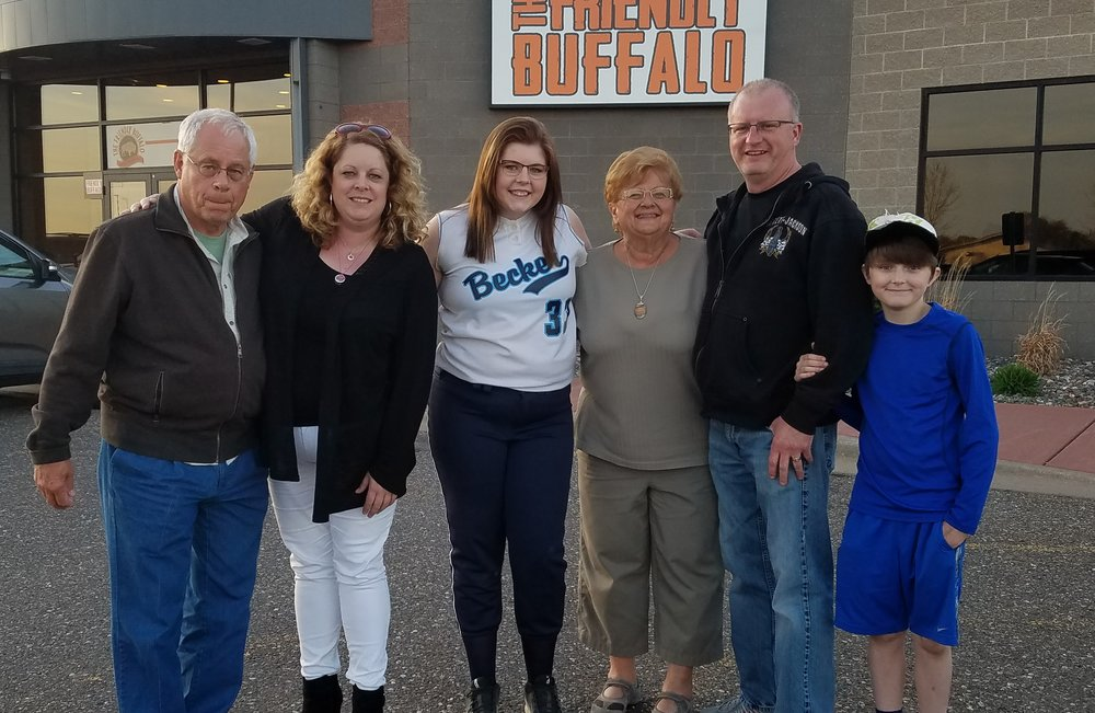 Bonnie with her family, including her dad and stepmom.