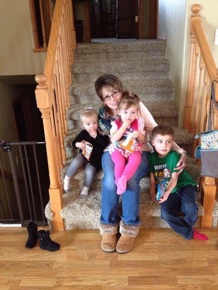 Lisa with her grandchildren.