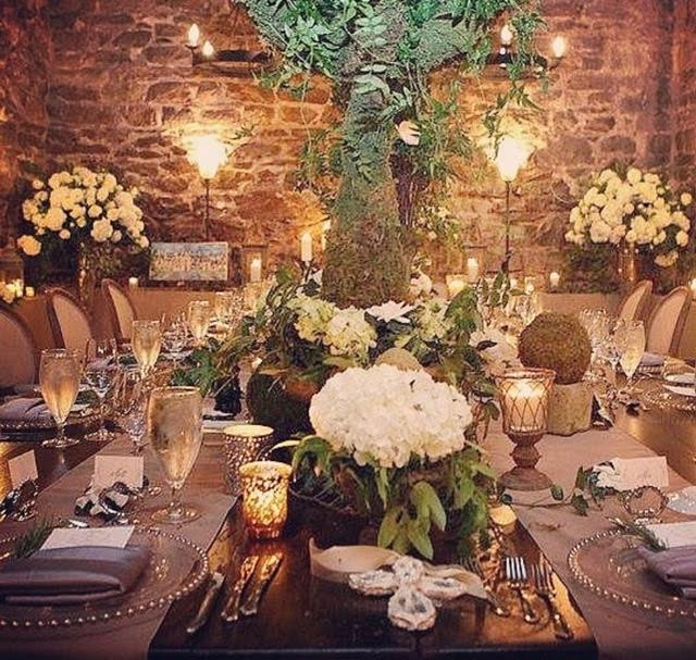 Large, hand crafted crosses, were the centerpiece, of this intimate Biltmore wedding. Also displayed in the corner, is one of four of her commission oil paintings,of the iconic venue. These were given as gifts to family members.