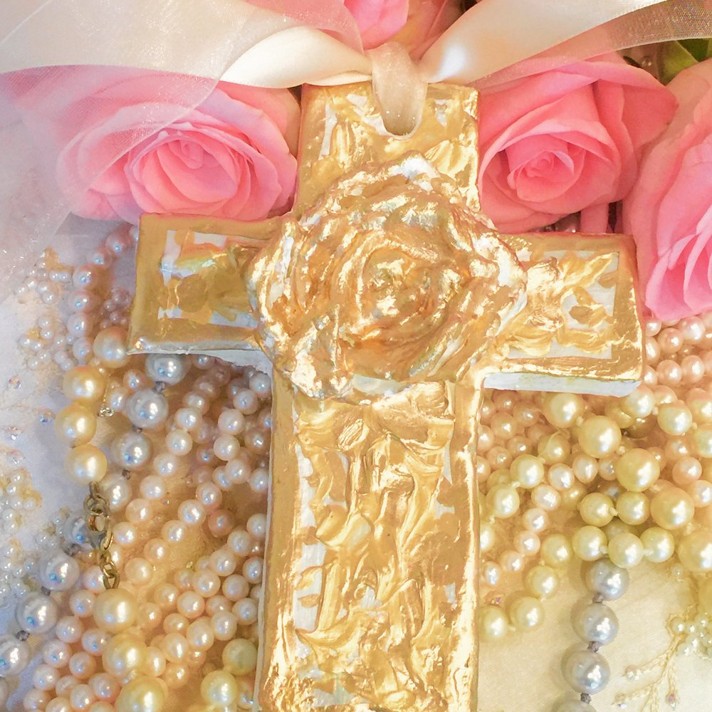 Gilded cross with intricate gold leaf design.