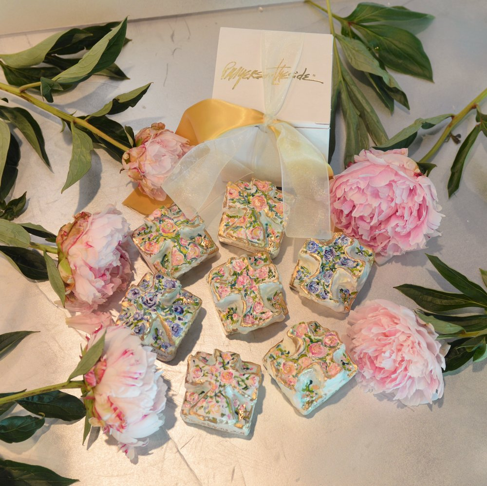 Hand Crafted and painted, crosses. The message on them asks the bride's friends to be bridesmaids.