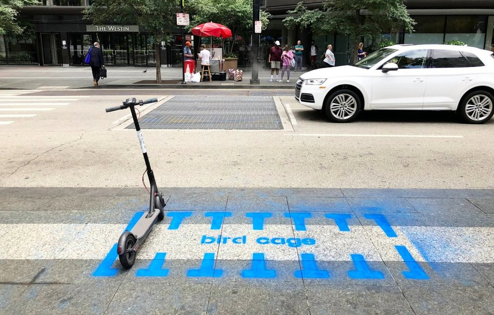 "A group of tactical urbanists installed ""Bird Cages"" last week in public spaces around downtown Cincinnati in order to spur some creative thinking about how cities can adapt to the dockless scooters fad instead of outright ban them. (photo via  Yard & Company )"