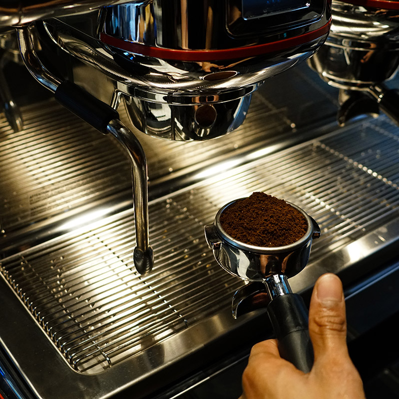 web espresso machine and grinds.jpg