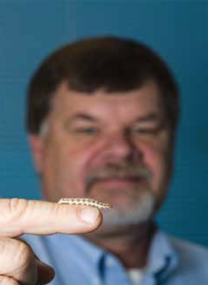 Ric Bessin displays a corn earworm.