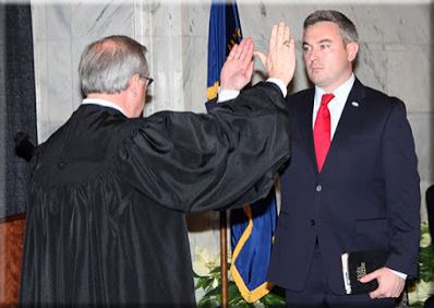 Kentucky Agriculture Commissioner Ryan F. Quarles, right, is sworn into office by state Chief Justice John D. Minton Jr. on Monday in the Capitol Rotunda in Frankfort. (Kentucky Department of Agriculture photo)
