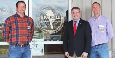 Agriculture Commissioner Ryan Quarles visited Trackside Butcher Shoppe March 28 in Campbellsburg. He was given a tour of the Kentucky Proud meat processing facility by co-owners Chris Wright, left, and John Edwards. (Kentucky Department of Agriculture photo)
