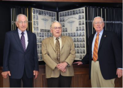 Alabama native Dr. John Thomas Vaughan and Kentuckians Dr. Abram G. Allen, Jr. and Dr. Steele Mattingly posed in front of their class photo taken in 1955.