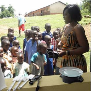 Children line up for mealtime at the Kentucky Academy in Adjeikrom, Ghana. Photo provided by Janet Mullins