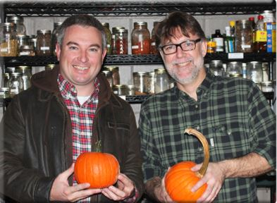 Mark Jensen, right, owner/executive chef of middle  fork kitchen bar, and Agriculture Commissioner Ryan Quarles hold Kentucky Proud pumpkins from Stonehedge Farm in the fall of 2016 that Jensen used to make fire-roasted candy pumpkins.