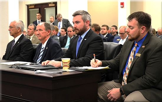 Agriculture Commissioner Ryan Quarles, second from right, testifies in support of House Bill 174 in Wednesday's meeting of the House Agriculture Committee in Frankfort.