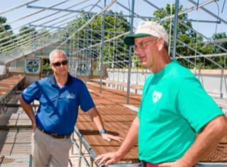 Robbie Smith and Keith Veech discuss Veech's new propagation house, buildt on the bones of the old hog nursery barn.