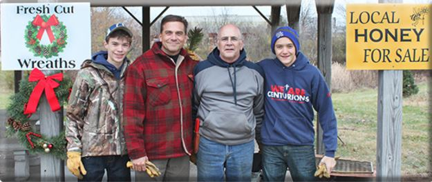Shelby County Christmas Tree Farm & Nursery partners Vivek Sarin, second from left, and Ron Stella, second from right, are joined by Sarin's sons Braden, left, and Cameron, who work at the 4-acre Shelbyville farm.