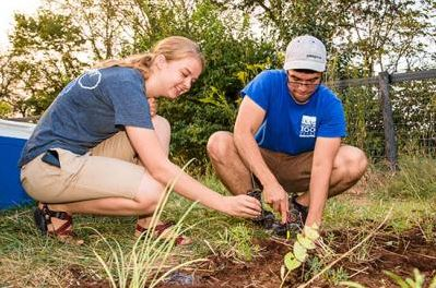 Rachel Hart and Jerrod Penn plant a monarchwaystation on UK's Spindletop Farm.