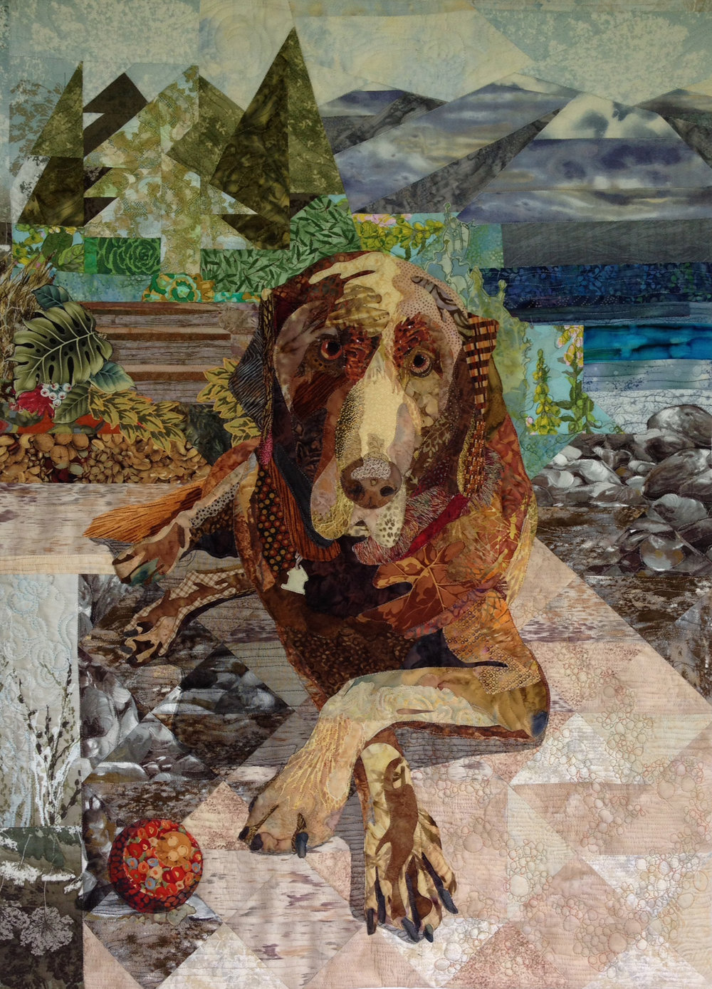 """Aussie - 29"""" x 40""""Judges' Choice Canadian Quilt Association National Juried Show 2015My inspiration is the character of a west coast family's Chocolate Labrador Retriever. He's the (old) man of the house who commands importance within the family and his environs. He draws you in to his world and dares you to throw the ball one more time!Technique: free motion quilting."""