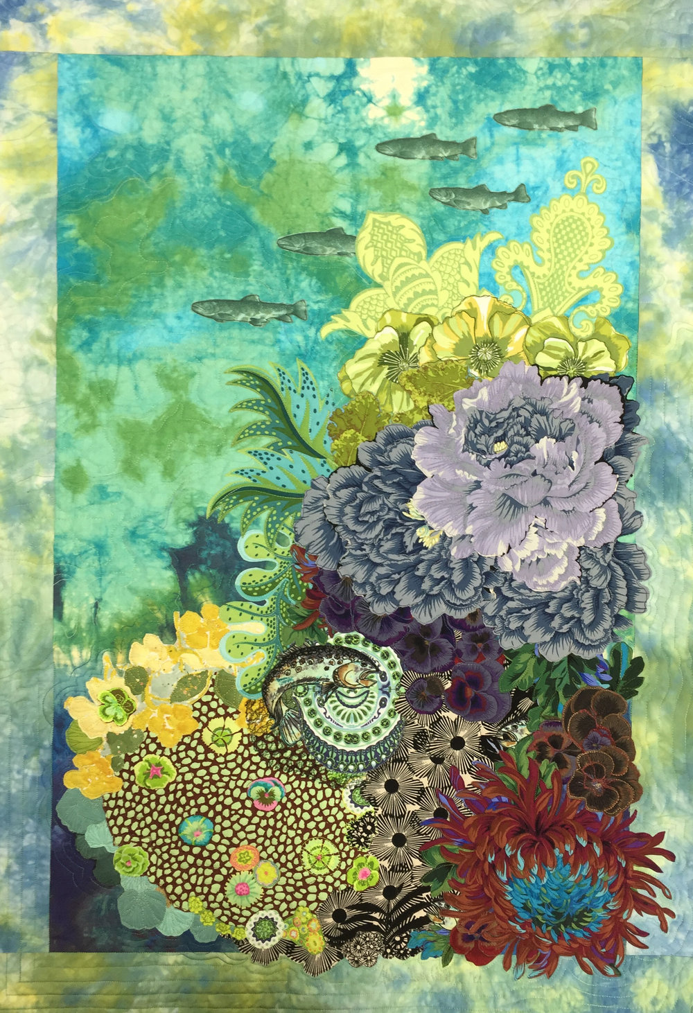 "underwater illusion - 24"" x 36""Inspired by bold floral printed fabrics and underwater experiences I set out to interpret my scuba diving experience underwater. Mixing hand dyed fabrics and commercial motif patterns designed and collaged an ideal underwater garden."