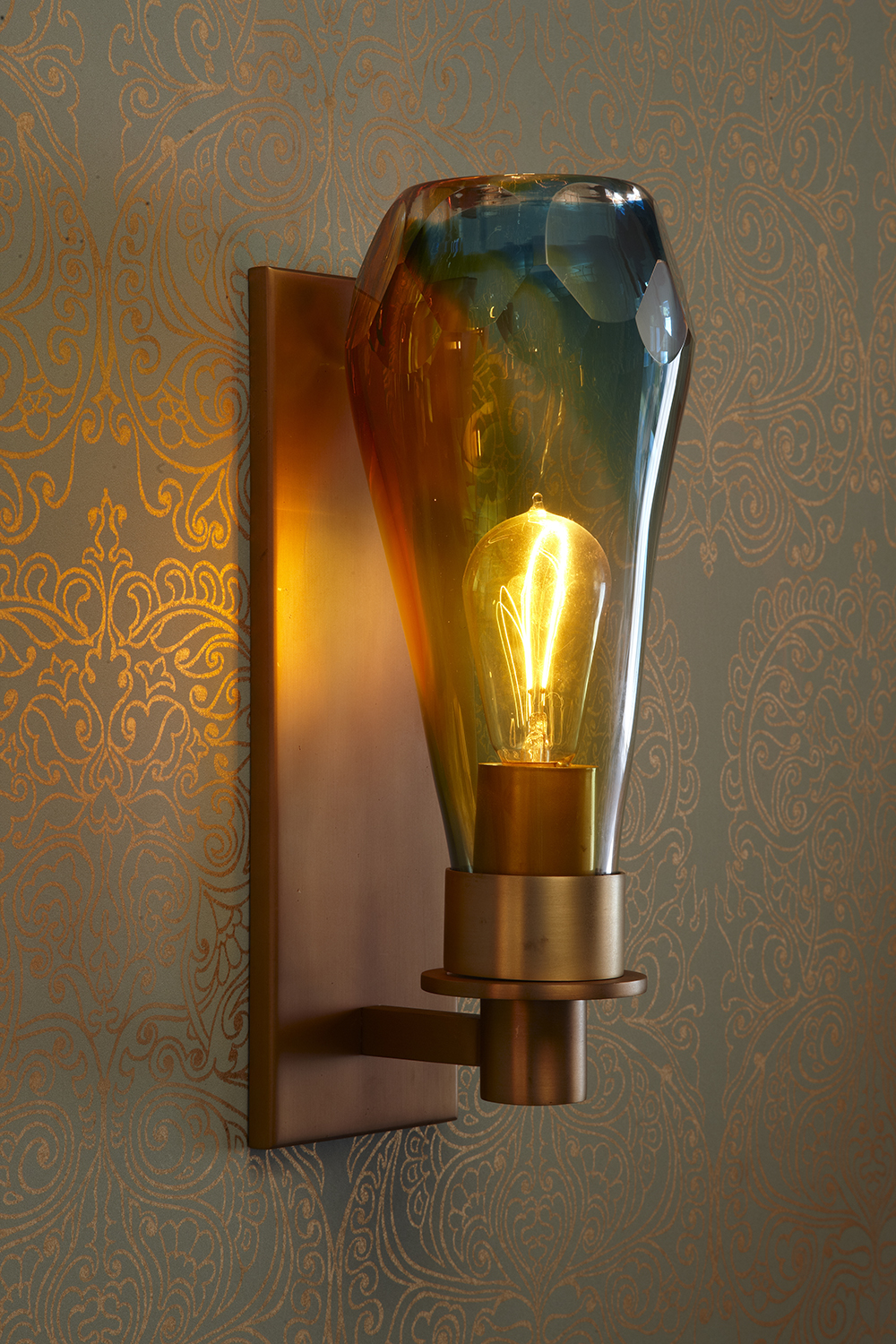 Glass + Crystal_W-117_Cut Crystal Sconce_Satn Brass_Blue and Amber_on.jpg