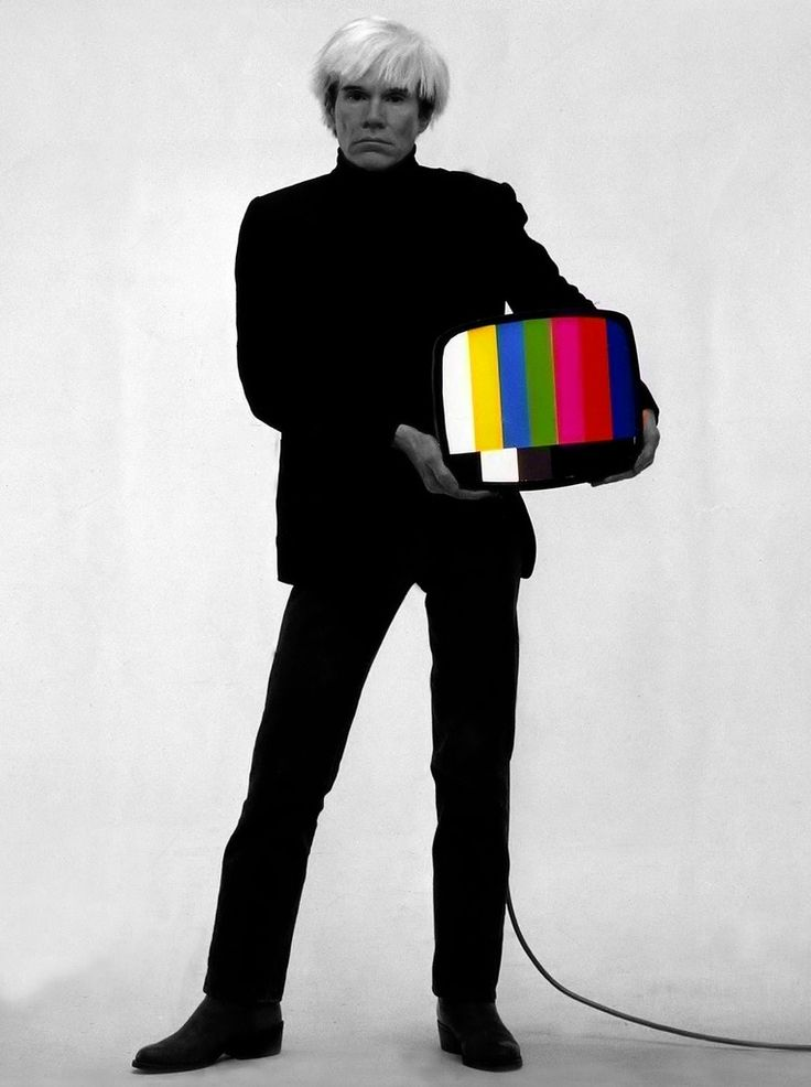 Andy Warhol with a television set.