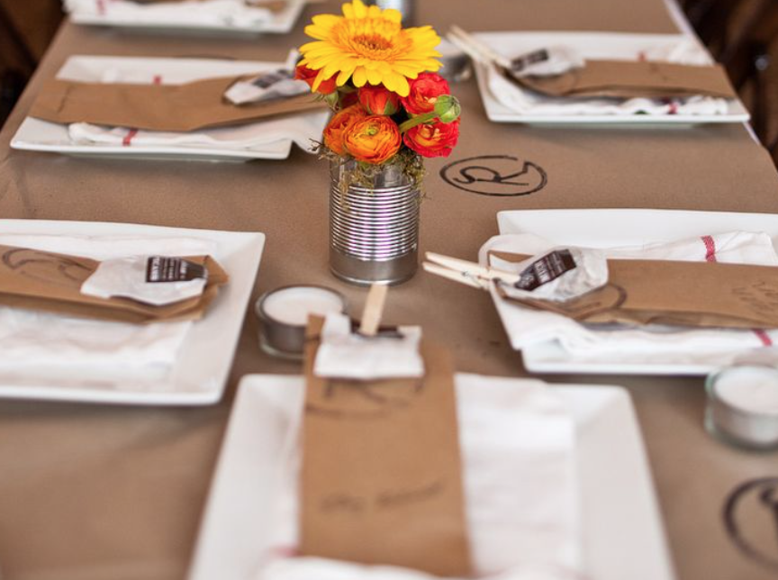 Kraft Paper Kid's Table Tablecloth - A roll of kraft paper makes a fun tablecloth for the kids' table—make sure to set out tin pots filled with crayons (and pears, for decoration).