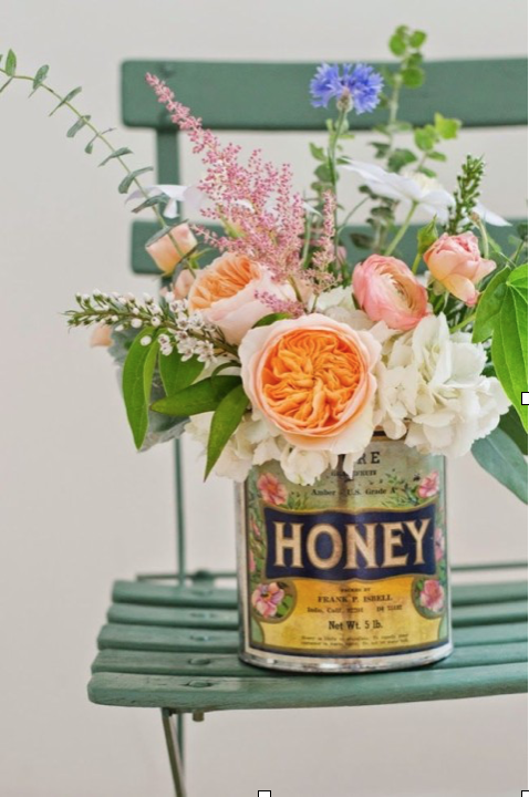 Spice Tin Flower Arrangements - Decorate your dinner table, entry way, or kitchen counters with these inexpensive arrangements made from wildflowers and spice tins. Feel free to use containers in various heights and sizes.