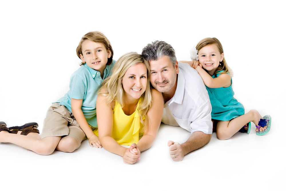 Portrait of a Family of four on a white background in the studio