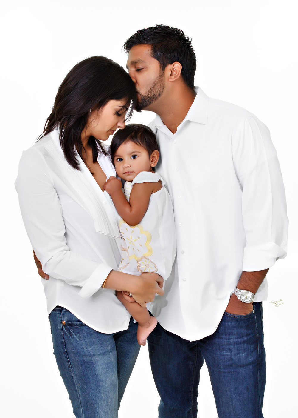 Portrait of Family of  three with young child on a white background in the studio