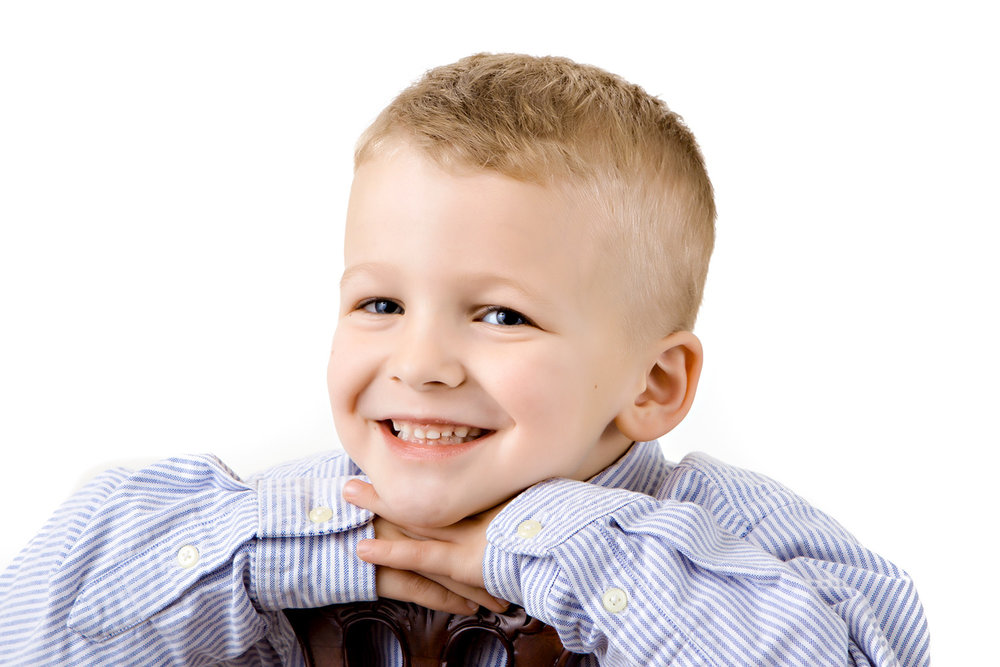 Portrait of  a young boy in the studio on a white background
