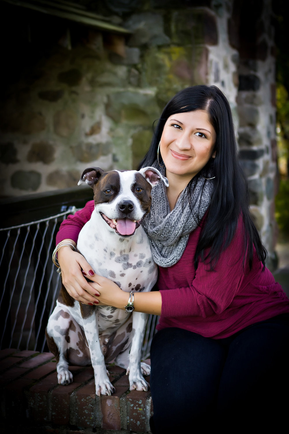 Portrait of  a woman and her dog at the park in Paramus