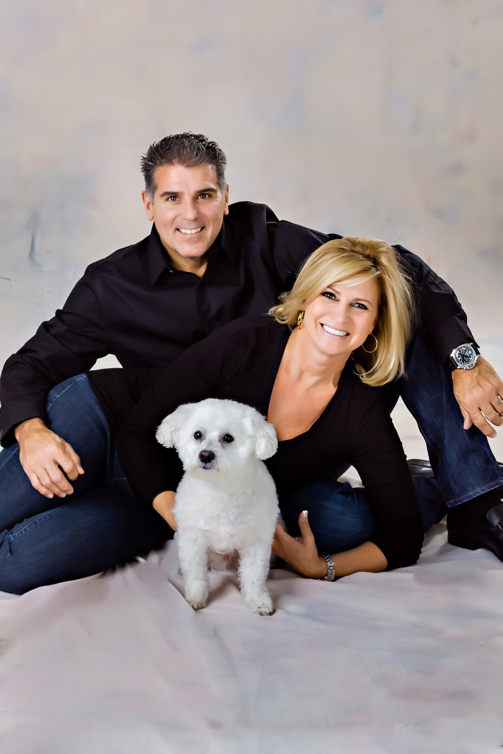 Portrait of  a couple and their dog in the studio in Maywood