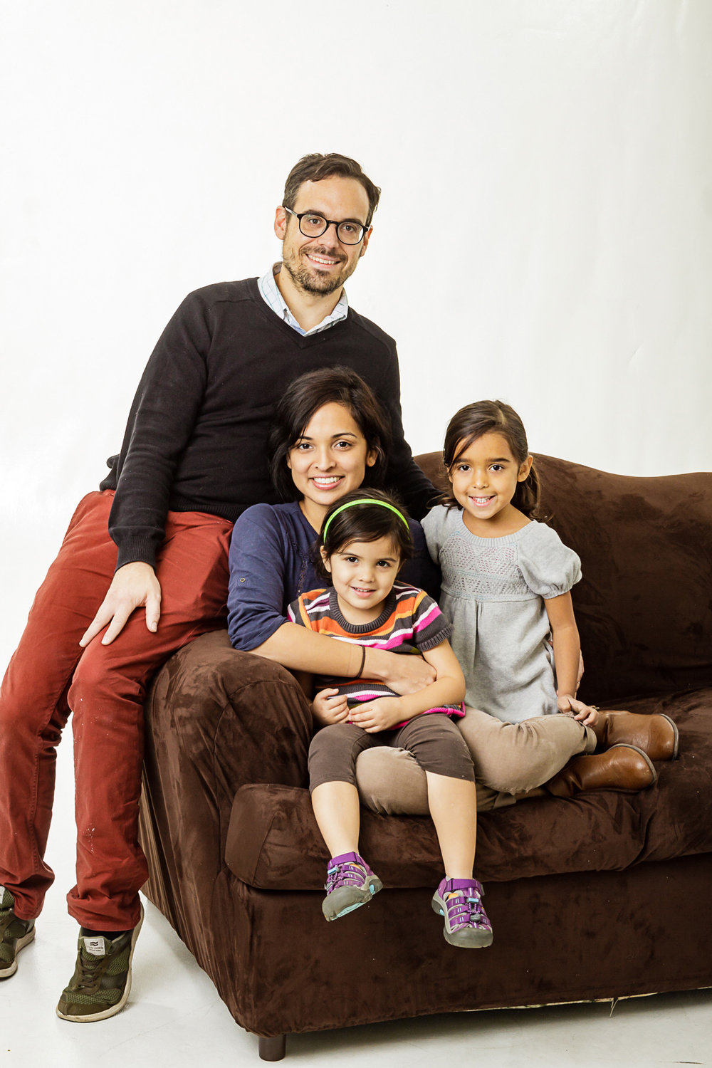 Casual Portrait of  family of  four on brown couch in the studio in Maywood