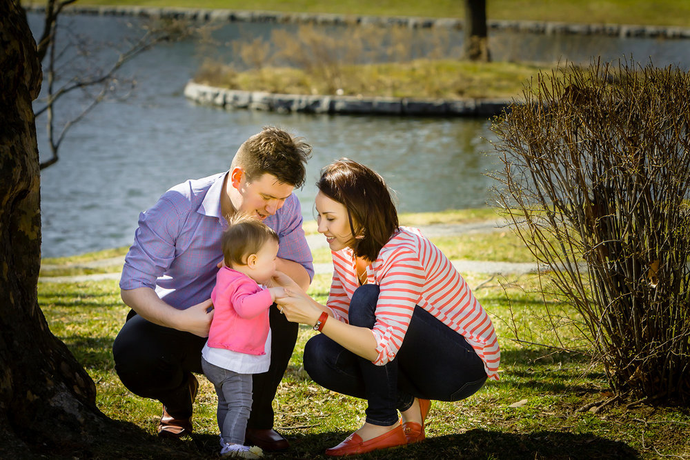 Portrait of  a couple and their baby in the park in Montclair New Jersey