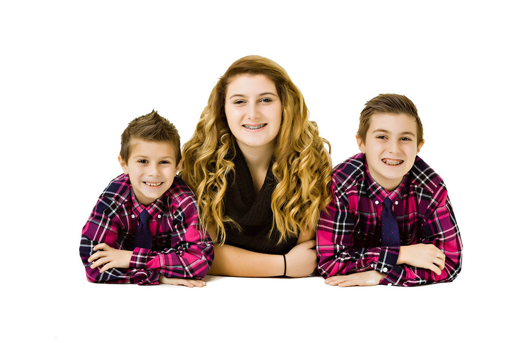 Casual Portrait of  three children in the studio on a white background