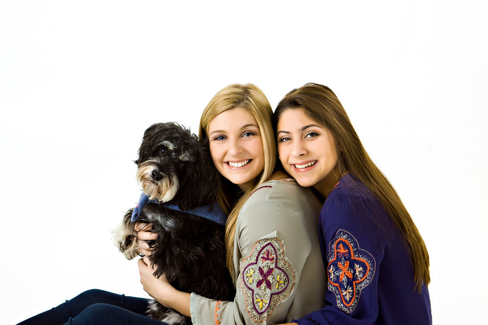 portrait of two young ladies with their dog