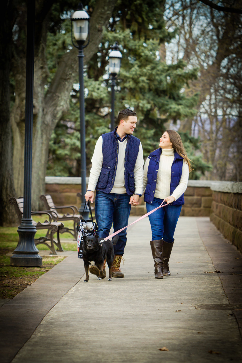 Engagement Photography couple walking their dog for their engagement session at Lambert Castle.