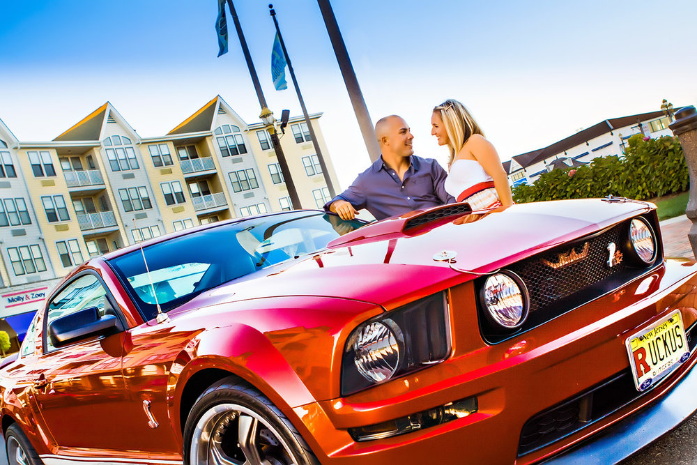 Engagement Photography couple with red mustang down in long Branch