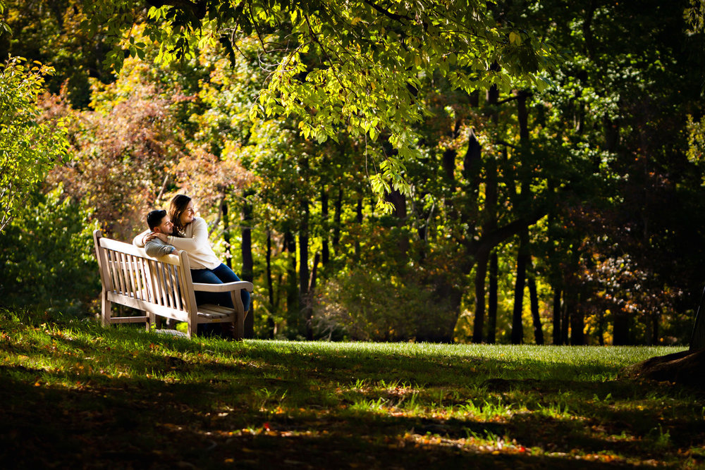 Photos of an engagement couple on a bench at Skylands manor ringwood new jersey