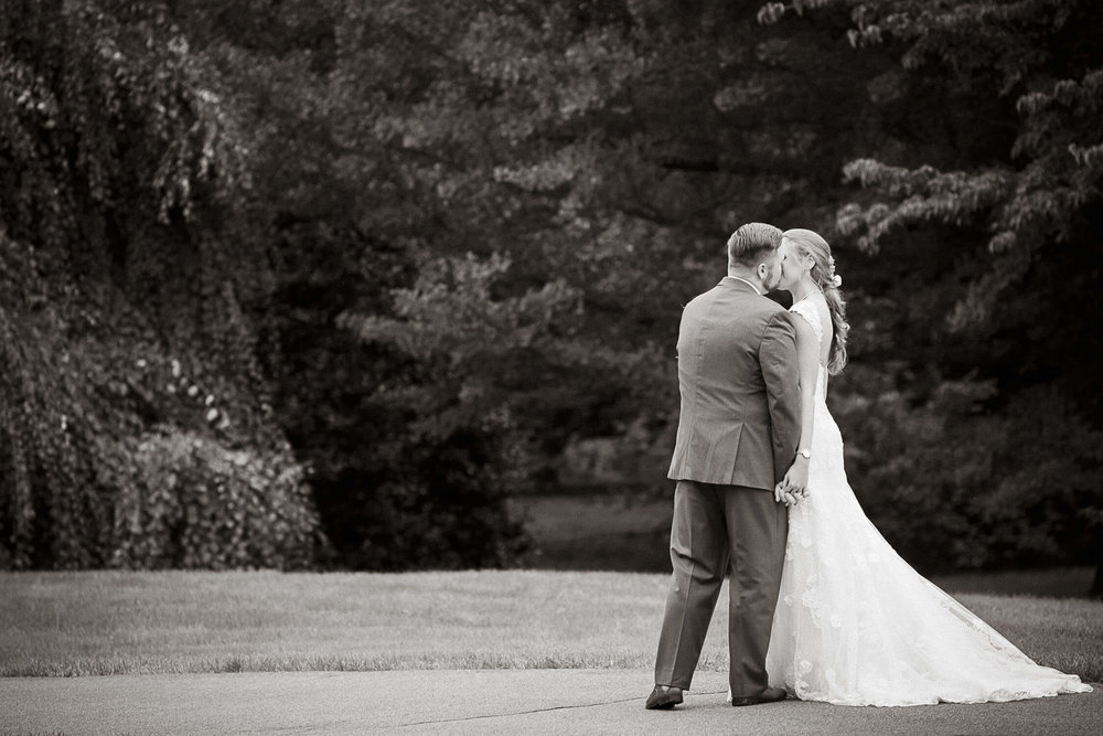 Bride and groom kissing at the Morristown New Jersey Frelinghuysen Arboretum