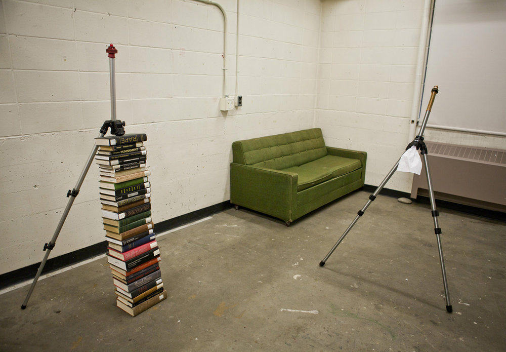 aluminum tripod, book, latex condom, 200 x 80 x 70 cm (Installation view)