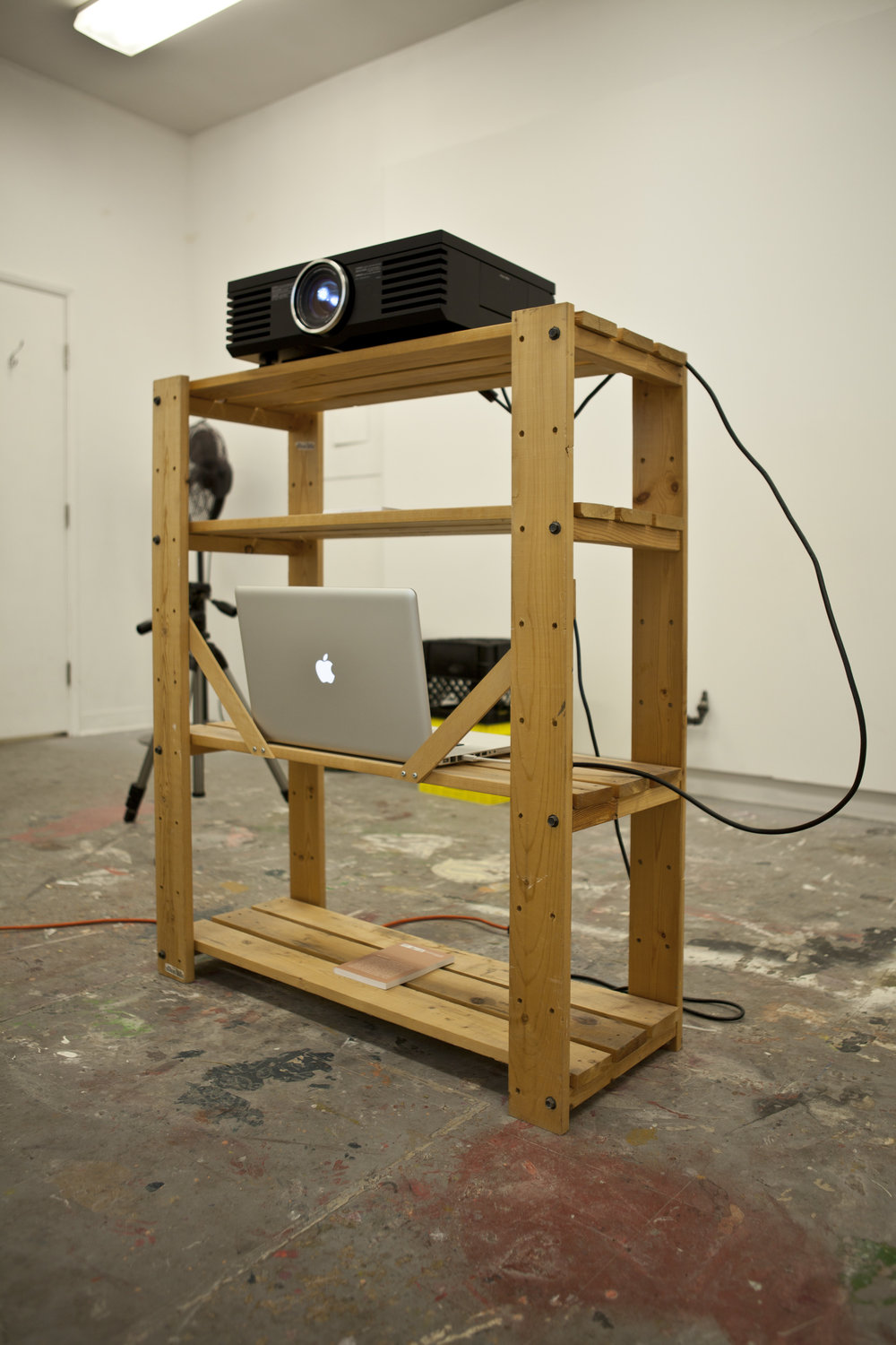 """Installation detail Wooden shelf, HD Projector, Apple Care Package,17"""" McBook Pro,Book"""