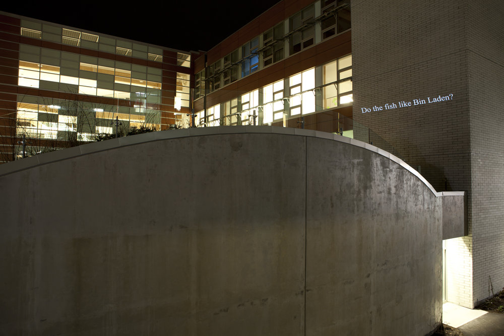 "HD Text projection onto UBC's building of  Centre for Interactive Research on   Sustainability. ""  Do the Fish Like Bin Laden? """