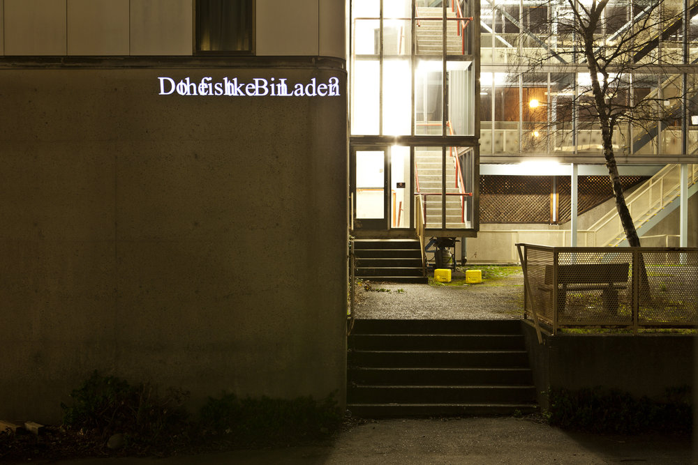 "HD Text projection onto UBC's Power building  ""  Do the Fish Like Bin Laden? """