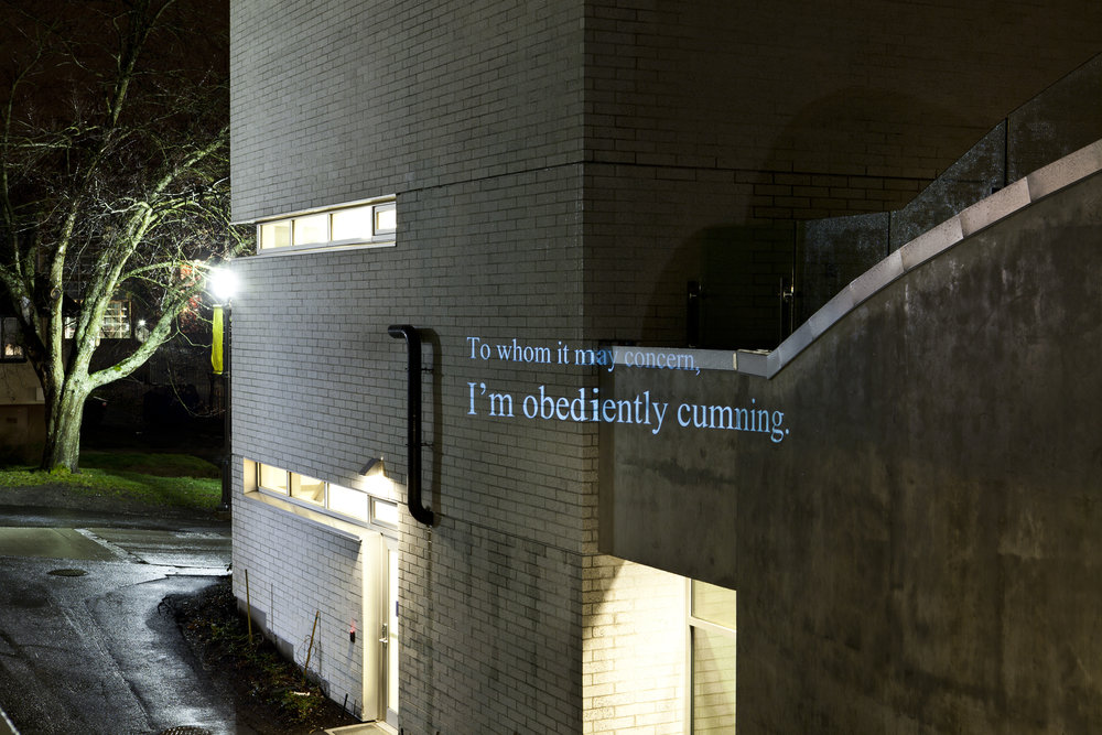 "HD Text projection onto UBC's building of  Centre for Interactive Research on   Sustainability. ""  To Whom It May Concern, I'm Obediently Cumming """