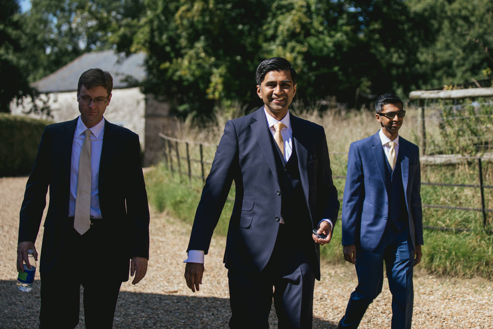 Outdoor wedding at Pennard House, Somerset_grooms arrives with groomsmen