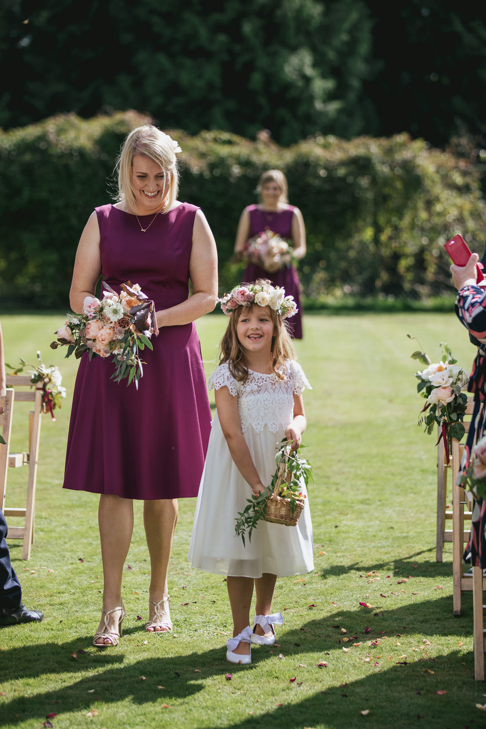 Outdoor wedding at Pennard House, Somerset_bridesmaids walk down the aisle