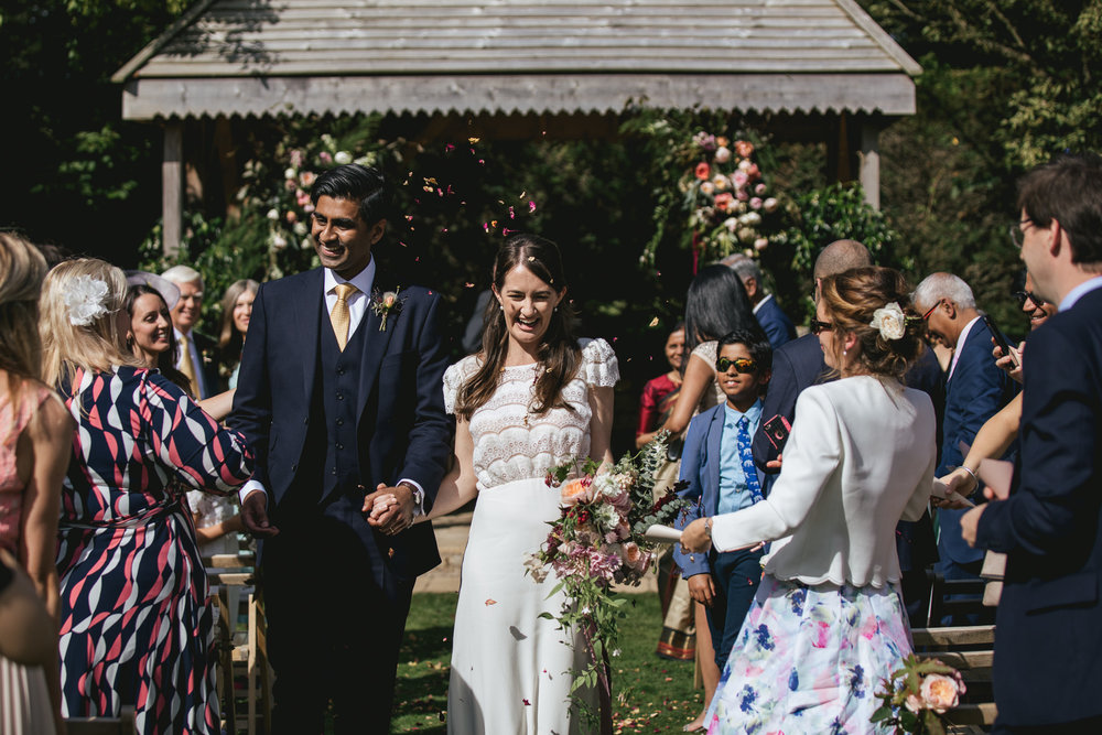 Outdoor wedding at Pennard House, Somerset_bride and groom showered with confetti