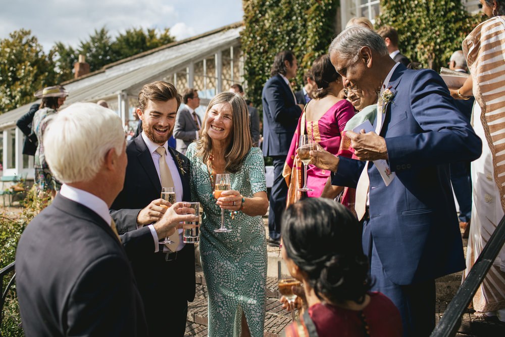Outdoor wedding at Pennard House, Somerset_guests celebrate with drinks