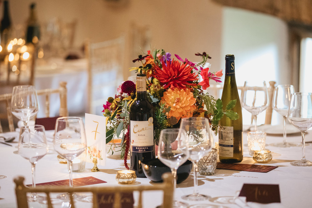 Outdoor wedding at Pennard House, Somerset_dining tables with flowers