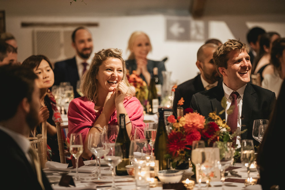 Outdoor wedding at Pennard House, Somerset_guests laugh during speeches