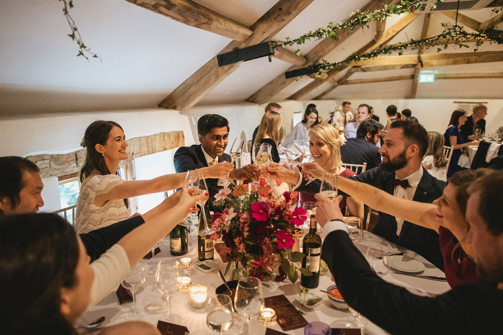 Outdoor wedding at Pennard House, Somerset_guests raise their glasses